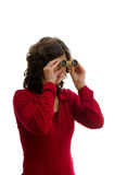 Woman with a pair of binoculars. Woman in red dress with a pair of binoculars Royalty Free Stock Images