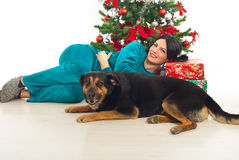 Woman in pajama and dog near Xmas tress Royalty Free Stock Photography