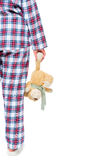 Woman in pajamas with a bear plush, space on the right Royalty Free Stock Photos