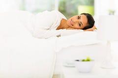 Woman pajamas bed Royalty Free Stock Photo