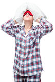 Woman in pajamas can not fall asleep, covered her head Stock Photography