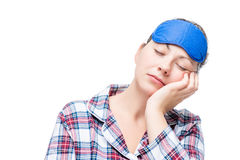 Woman in pajamas fell asleep in a sitting position Stock Photography
