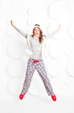Woman in pajamas and hat fooled Royalty Free Stock Images