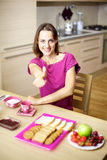 Woman in pajamas having breakfast thumb up Stock Photography