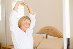 Woman in pajamas stretching Royalty Free Stock Image