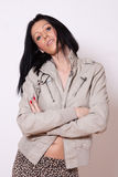A woman in a pale jacket Stock Images
