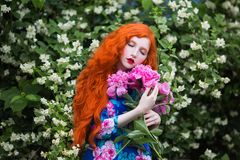 Woman with pale skin and long red hair Royalty Free Stock Photos