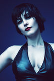 Woman with pale skin and red lips. On blue background Royalty Free Stock Image