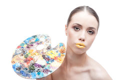 Woman with palette Stock Images