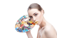 Woman with palette Royalty Free Stock Photo
