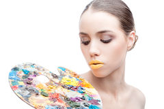 Woman with palette Royalty Free Stock Images