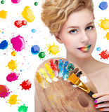 Woman with palette Royalty Free Stock Photography