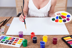 Woman with palette and brush Stock Photo