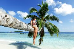 Woman on palm on sea backgroud Stock Image