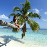 Woman on palm on sea backgroud Royalty Free Stock Photo
