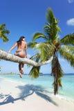 Woman on palm on sea backgroud Stock Photo