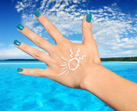 Woman palm with sunscreen lotion Stock Photo