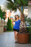Woman and palm tree Royalty Free Stock Photography