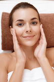 Woman palms her face at spa Stock Photography