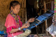 Palong Hill Tribe Woman, Northern Thailand. Woman from Palong tribe with traditional clothes, working on a loom, Chiang Rai, Thailand, Asian royalty free stock images