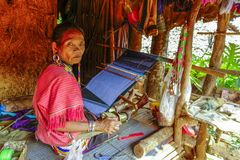 Palong Hill Tribe Woman, Northern Thailand. Woman from Palong tribe with traditional clothes, working on a loom, Chiang Rai, Thailand, Asian royalty free stock photography
