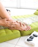 Woman pampering her feet Royalty Free Stock Image