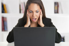 Woman in Panic Looking At A Computer Monitor Stock Photography