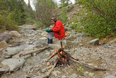 A woman panning for gold in northern bc royalty free stock photo