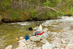 A woman panning for gold at spruce creek, bc Stock Image