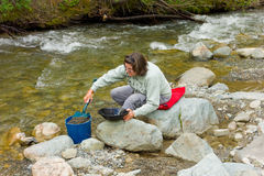 A woman panning for gold at spruce creek, bc Royalty Free Stock Images