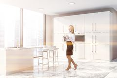 Woman in panoramic beige kitchen corner royalty free stock images