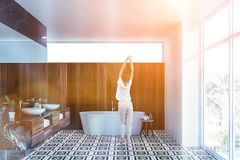 Woman in panoramic black marble bathroom royalty free stock photo