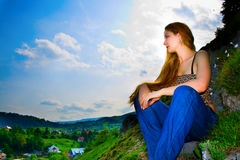 Woman and panoramic rural mountain view Stock Images