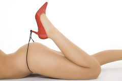 Caucasian woman dressed in red highheal shoes and  thong panties Royalty Free Stock Photo