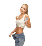 Woman with pants and pills Stock Image