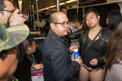 A woman without pants on the subway during the Stock Images