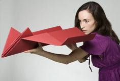 Woman with paper airplane Royalty Free Stock Photos