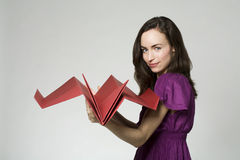 Woman with paper airplane Stock Photos
