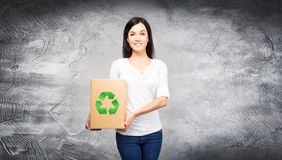 Woman with a paper bag with an ecology symbol Stock Photo