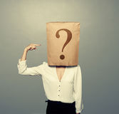 Woman with paper bag pointing at question Stock Photography
