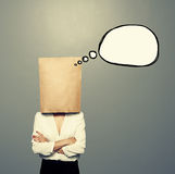 Woman with paper bag and speech balloon Royalty Free Stock Images