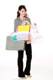 Woman with paper bags. Young smiling asian woman with paper bags Stock Photography