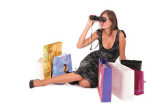 Woman with paper bags and binocular Stock Images