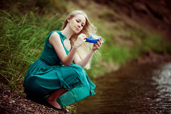 Woman with a paper boat Royalty Free Stock Photo