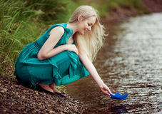 Woman with a paper boat Royalty Free Stock Photography