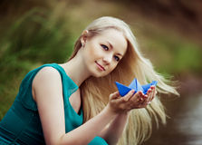 Woman with a paper boat Royalty Free Stock Image