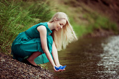 Woman with a paper boat Royalty Free Stock Images