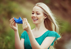 Woman with a paper boat Stock Image