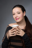 Woman with a paper cup of coffee Royalty Free Stock Image