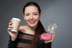 Woman with a paper cup of coffee Stock Images